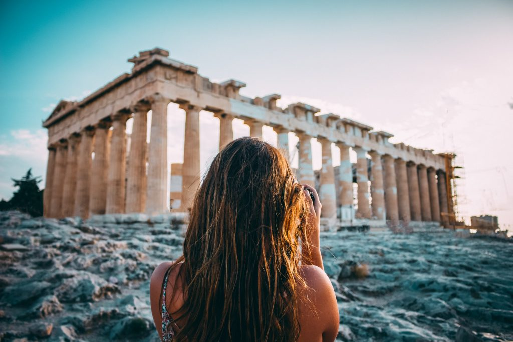 A Woman is taking a photo of The Temple of Parthenon, Acropolis, Private Tour Athens