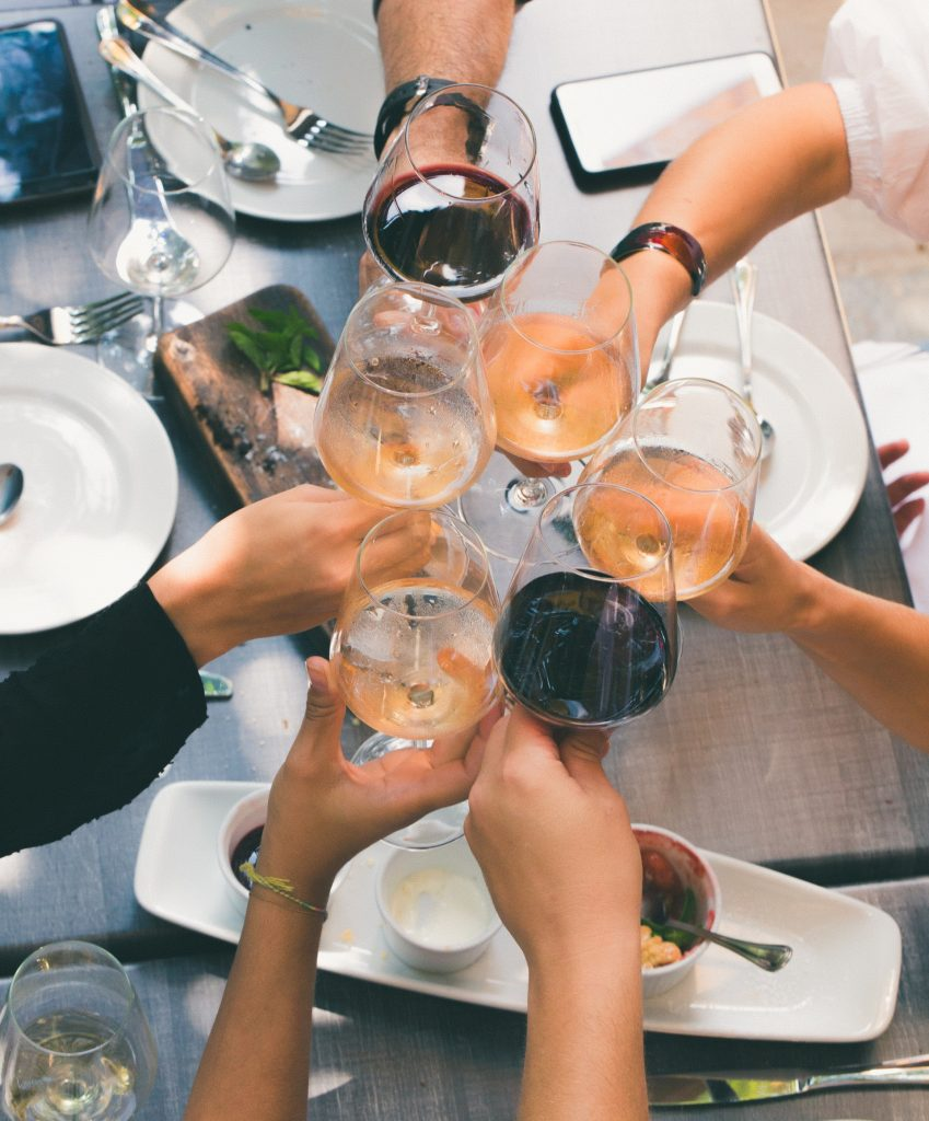 People holding glasses of wine, Athens Food and Wine Tours
